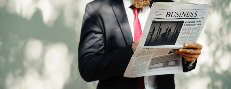 Man Reading Newspaper Business Section