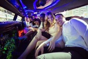 Friends sharing a limo